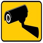 yellow and black cctv camera sign