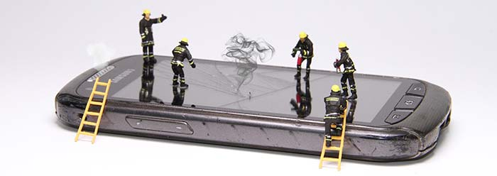 model fireman on top of a mobile phone